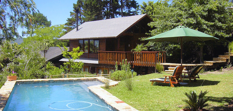 Pool and main cottage at Zauberberg Cottage