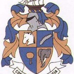Knysna's Coat of Arms displaying a horse, a tree, an elephant and a saw
